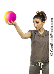 young woman looking up to a ball