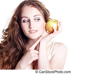 Young woman looks at apple