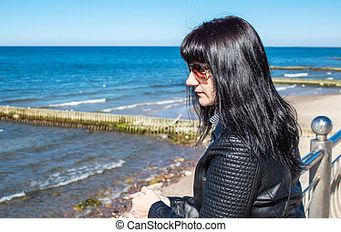 young woman looks at the sea portrait closeup
