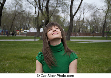 young woman looks at the top