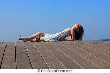 young woman lying and looking at the sky