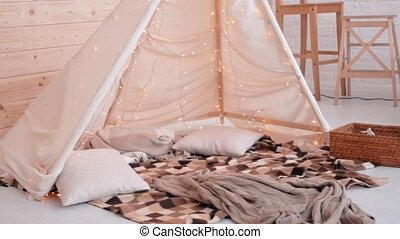 Young woman lying on the floor under christmas tent. New year concept