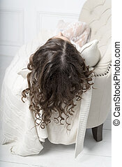 Young woman lying on the sofa with her hair.
