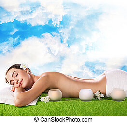Young woman lying on the table and waiting massage.