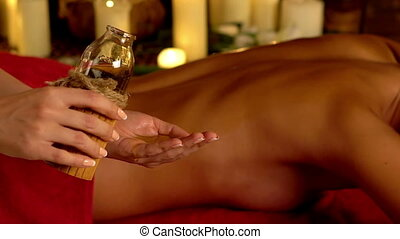 Young woman lying on wooden spa massage bed. - Young woman...