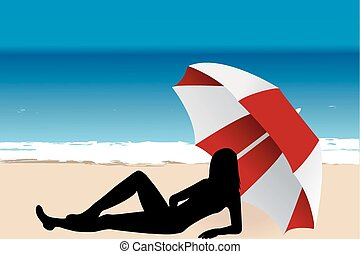 Young woman lying under an umbrella on the beach