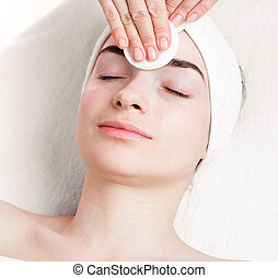 Young woman make up removing in beauty parlour - Young woman...