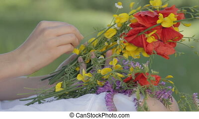 Young woman makes bouquet on nature - CLIP EDIT Young woman...