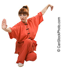 young woman makes kung-fu exercise isolated with clipping...