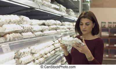 Young woman makes purchases in the supermarket