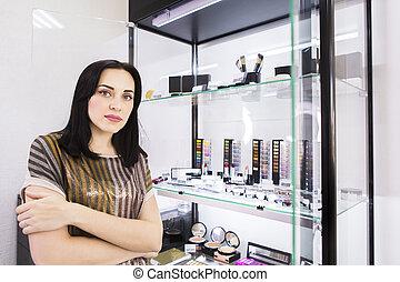 Young woman makeup artist with beautiful makeup