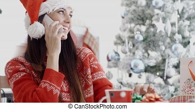 Young woman making a Christmas greeting call