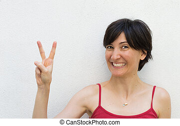 Young Woman Making a Peace Sign - Young Woman Making Peace ...