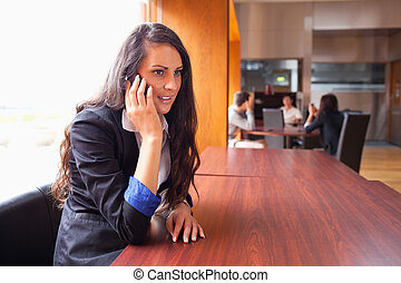 Young woman making a phone call
