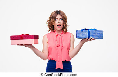 Young woman making choice between gifts