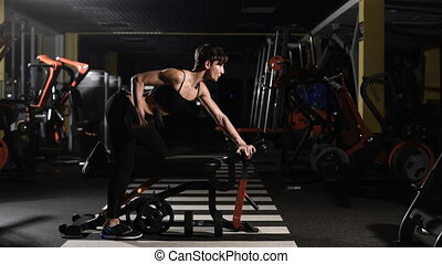 Young woman making exercise at the gym