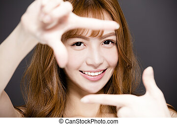 young woman making frame with hands and Beautiful eyes concept