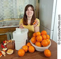 woman making fresh orange juice