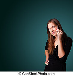 Young woman making phone call with copy space