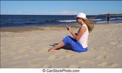 woman making photo of her kids on the sea beach