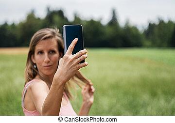 Young woman making selfies