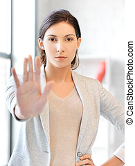 young woman making stop gesture
