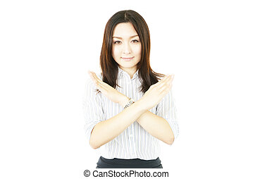 Young woman making stop sign - Young japanese woman making...