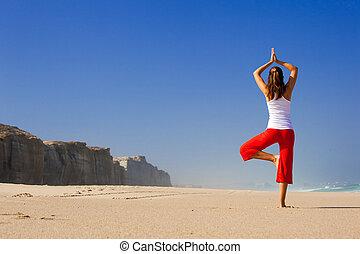 Young woman making Yoga