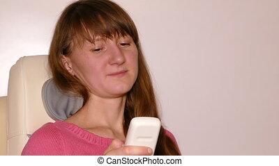 young woman massaged into modern automatic massage chair