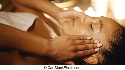 Young Woman Massaging Her Face