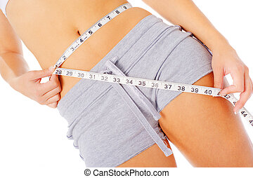 Young Woman Measuring Herself