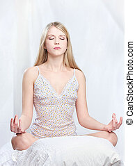 woman meditate at home - Young woman meditate at home