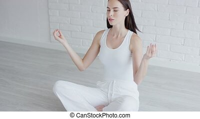 Young woman meditating and looking away - Pretty young lady...