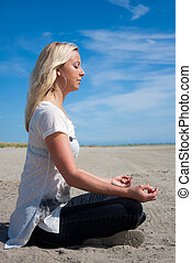 Young woman meditating from side
