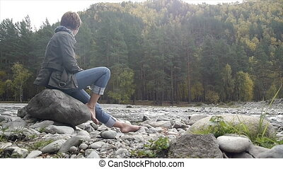 young woman meditating on the natur