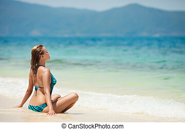 Young Woman Meditation At Tropical Beach
