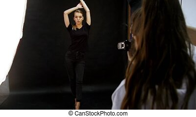Young woman model having a photo session in the studio....