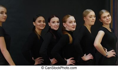 Young woman models having a photo session in the studio. Six...