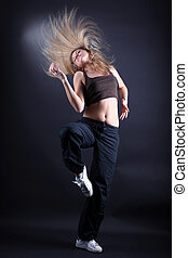 young woman modern dancer in action