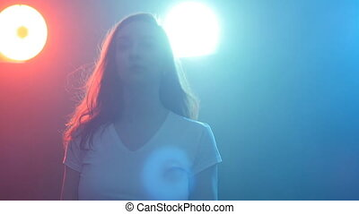 Young woman modern dancer in color light - Young woman...