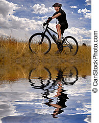 Young Woman Mountain Biking - Young Woman Riding Mountain ...