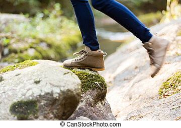young woman mountain climbing - young woman wearing hiking...