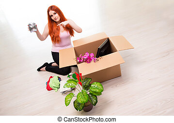 Young woman moving house in lifestyle concept