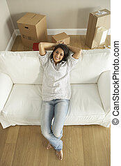 Young Woman Moving Into New Home