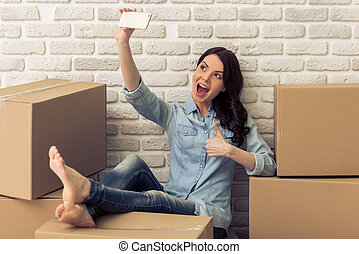 Young woman moving - Attractive young woman is moving,...