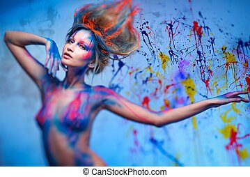 Young woman muse with creative body art and hairdo
