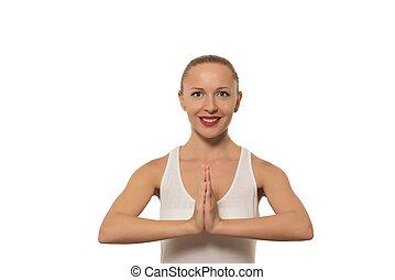 Young woman namaste on white