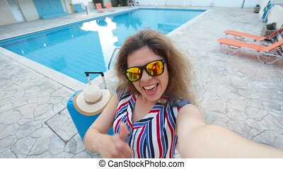 Young woman near a swimming pool