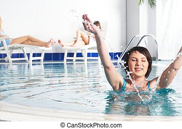 Young woman near pool