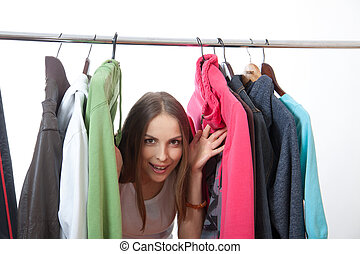 Young woman near rack with hangers